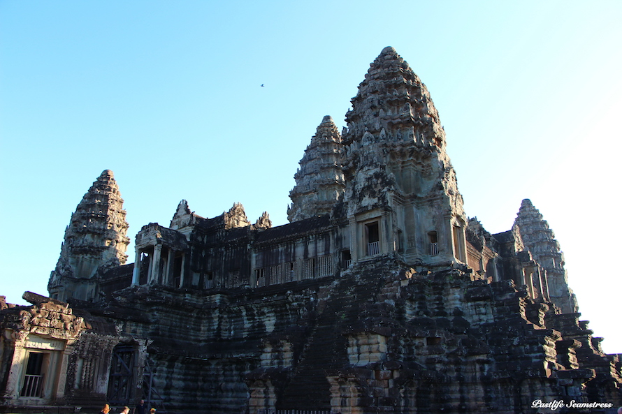 cambodia, siem reap, angkor wat, angkor wat sunrise, three day itinerary of angkor, best spot to watch sunrise at angkor wat, west gate vs east gate sunrise, things to do in siem reap, sunrise siem reap, angkor war temple pass, angkor wat do's and don'ts, bayon temple, which temples to see in cambodia, must see temples of siem reap, history of angkor wat, how to see angkor wat, angkor wat photographs, ta phrom, preah khan temple, dinosaur carving at angkor wat, shinta mani, how to dress for angkor wat, what to wear at angkor wat, apsara carvings at angkor wat, stone causeway over moat, stone causeway at angkor wat, vishnu shrine in angkor wat