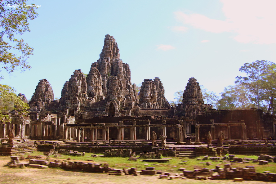 cambodia, siem reap, angkor wat, angkor wat sunrise, three day itinerary of angkor, best spot to watch sunrise at angkor wat, west gate vs east gate sunrise, things to do in siem reap, sunrise siem reap, angkor war temple pass, angkor wat do's and don'ts, bayon temple, which temples to see in cambodia, must see temples of siem reap, history of angkor wat, how to see angkor wat, angkor wat photographs, ta phrom, preah khan temple, dinosaur carving at angkor wat, shinta mani, how to dress for angkor wat, what to wear at angkor wat, apsara carvings at angkor wat, stone causeway over moat, stone causeway at angkor wat, vishnu shrine in angkor wat , Bayon temple, How to see temples at angkor, how to see temples at cambodia, must see temples of angkor